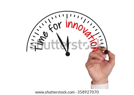 Human hand writing TIME FOR INNOVATION on whiteboard - stock photo