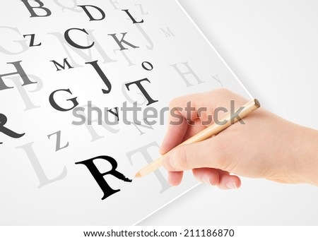 Human hand writing various letters on white plain paper