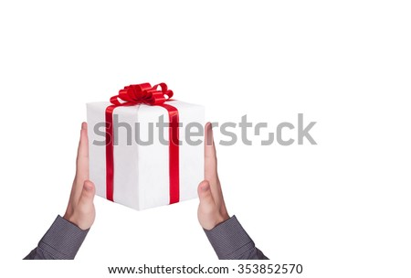 Human hands and gift box.  Christmas time - stock photo
