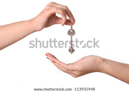 Human hands and key isolated on white background - stock photo