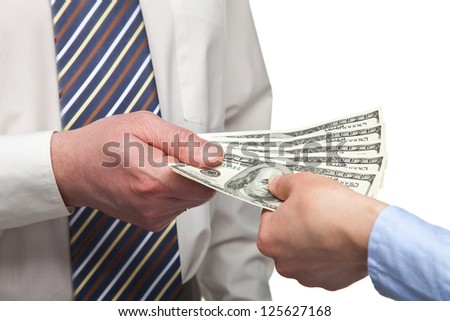 Human hands exchanging money on white background - stock photo