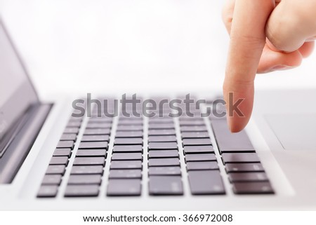 Human hands going to press a button on keypad in white isolated background - stock photo