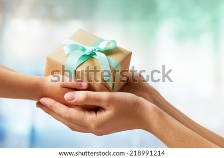 human hands holding a gift - stock photo