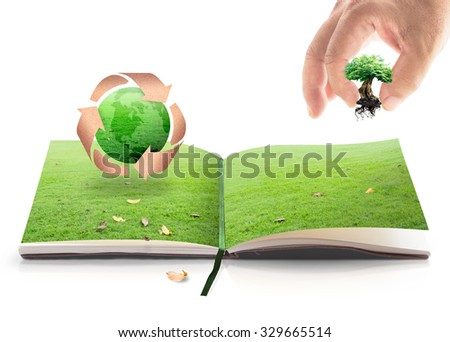 Human hands holding big tree and recycle arrow symbol made of old paper texture protecting green earth globe on book of nature. On white background. Saving world environmental, Soil Day concept.