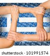 Human hands holding each other showing unity, on greece flag background, concept - stock photo