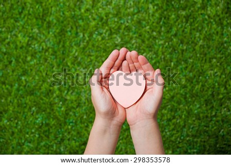 Human hands holding heart