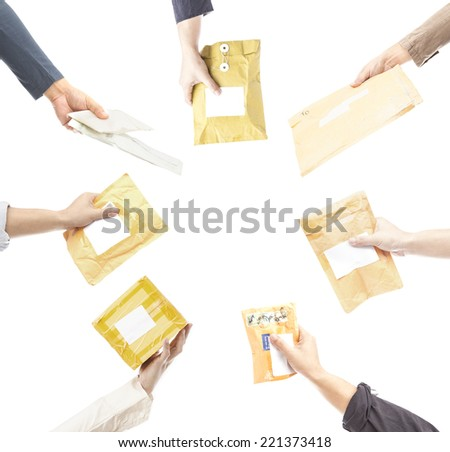 human hands holding  small parcels on white - stock photo