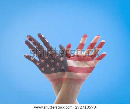 Human hands in American eagle bird form with double exposure of the United States of America flag pattern against bright blue sky background : USA Independence day and flag day concept    - stock photo