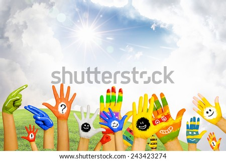 Human hands in colorful paint showing symbols - stock photo
