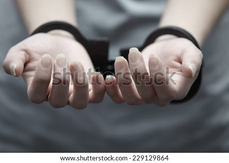 Human hands in handcuffs. Close-up horizontal view - stock photo