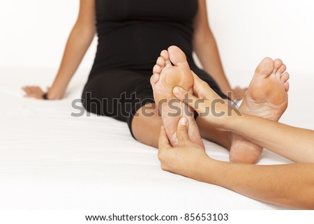Human hands massaging a woman's foot