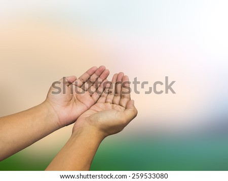 human hands of prayer over Blurred nature background - stock photo