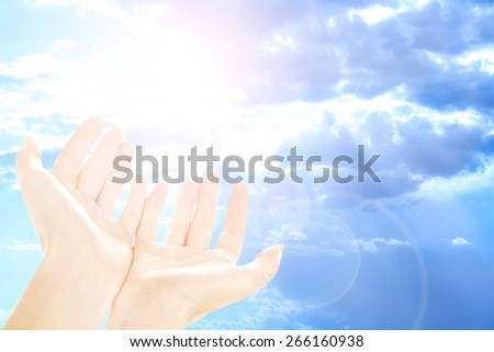 Human hands on sky background - stock photo