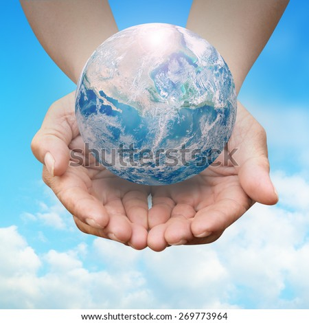 Human hands palm up with NASA global image as design element over white - stock photo
