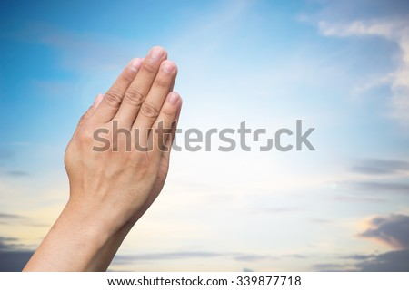 human hands prayer:man praying for peaceful and calm:helping hands concept:safe/save the world conceptual:pray for Turkey violence conception:strong together conceptual:assistance/support/keep calm. - stock photo