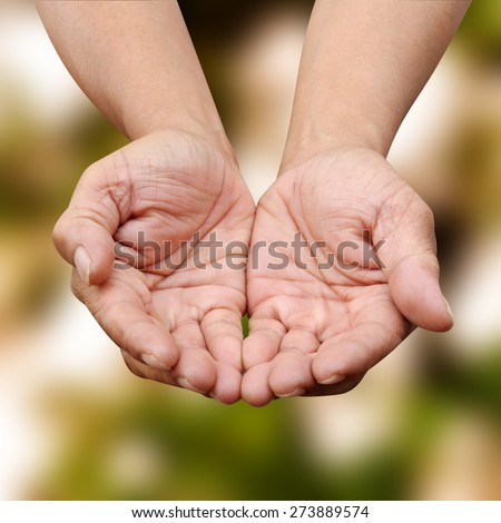 Human hands praying pray PARIS over blurred nature background