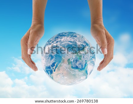 Human hands protect global Earth NASA image  over gas clouds and Sun a Think Earth Concept - stock photo