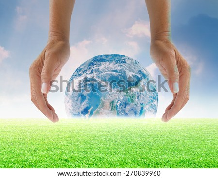 Human hands protect global Earth  over gas clouds and Sun a Think Earth Concept Elements of this image furnished by NASA - stock photo