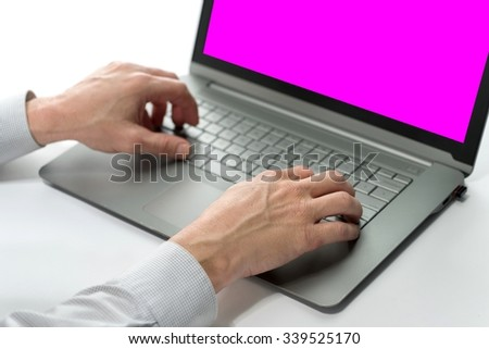 Human Hands Typing on the Laptop with Pink Screen Surface