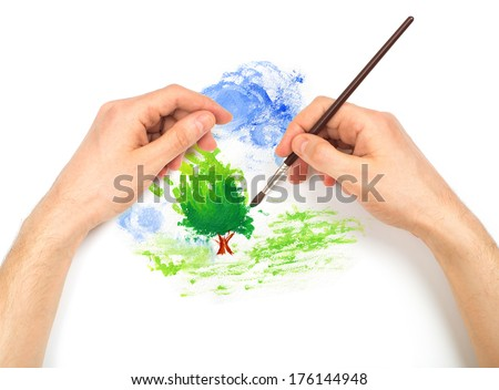 Human hands with brush painting nature landscape on white background - stock photo