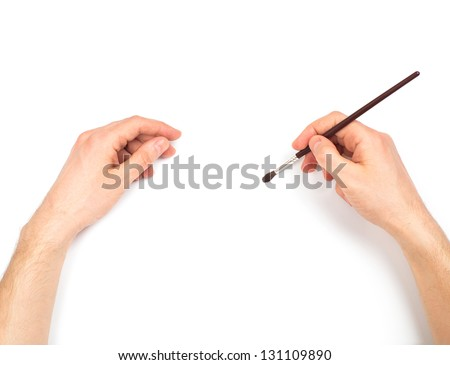 Human hands with brush painting something. On white background - stock photo