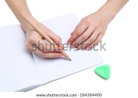 Human hands with pencil and erase rubber and notebook, isolated on white