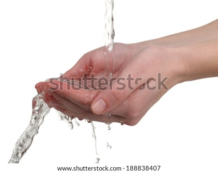 Human hands with water splashing on them isolated on white