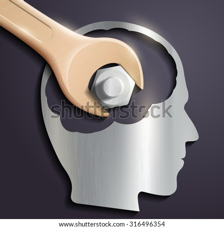 human head and a wrench with a nut - stock photo
