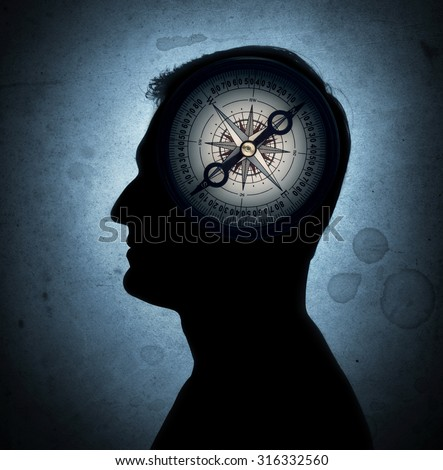 Human head and compass. The concept on the topic of philosophy, psychology, morality, etc. - stock photo