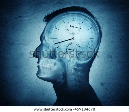 Human head silhouette with clock.