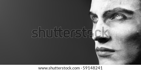 Human head with face-paint outdoors on a dark background. Monochrome photo with special darkness for dramatic view