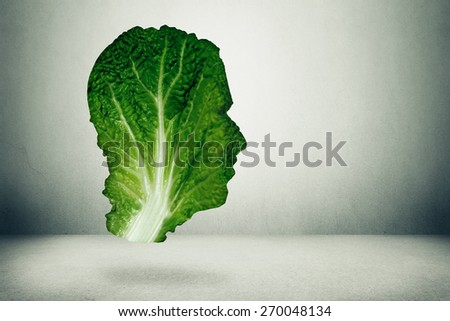 Human healthy diet concept. Dark green leafy kale or collard leaf shaped as head symbol of fresh vegetable eating intelligent dieting using farm fresh natural organic produce. Healthy lifestyle diet  - stock photo