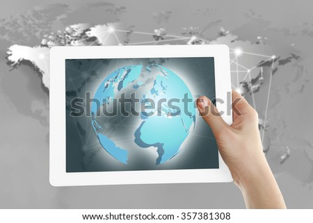 Human holding tablet pc  with world map and network on screen - stock photo