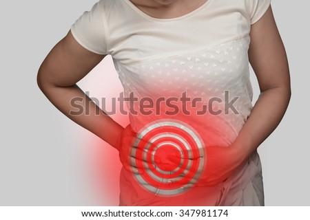 Human lumbar pain from kidney disease. - stock photo