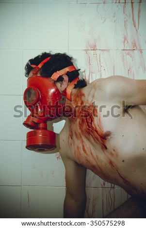 human naked man with red gas mask, blood, despair and suicide - stock photo