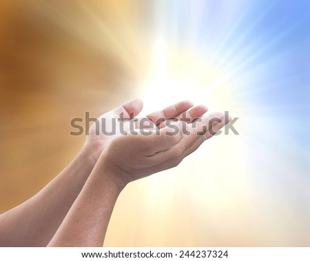 Human open empty hands with palms up, over blurred nature background - stock photo