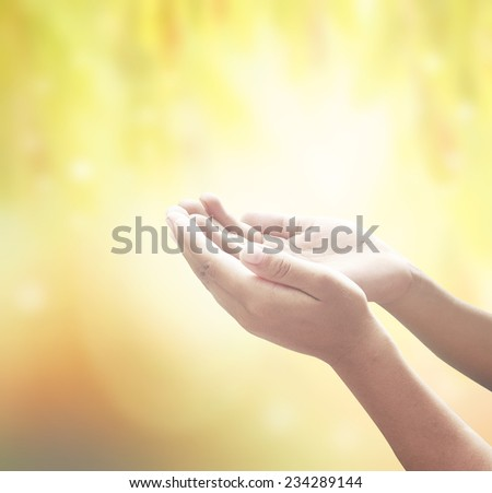Human open empty hands with palms up, over blurred nature background. Thanksgiving, Christmas, Health Care, Worship, Forgiveness, Repentance, Reconcile, Adoration, Glorify, Redeemer concept.