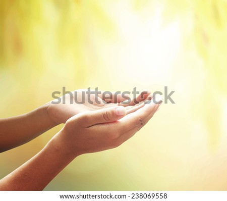 Human open empty hands with palms up, over blurred nature background. Thanksgiving, Christmas, Forgiveness, Mercy, Humble, Repentance, Reconcile, Glorify, CSR, Eco Friendly, Trust, Love concept.