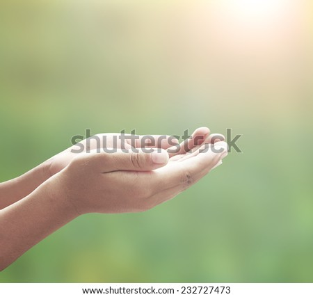 Human open empty hands with palms up, over blurred nature background. Thanksgiving Forgiveness Mercy Humble Repentance Reconcile Glorify Worship Redeemer Muslim Islam Love Trust Inspiration concept.