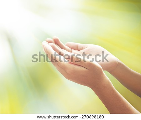 Human open empty hands with palms up over blurred sunrise with amazing light background. Pray for support concept. Business, Environment Day, Dignity, thanksgiving, faith, believe, hope, help concept. - stock photo