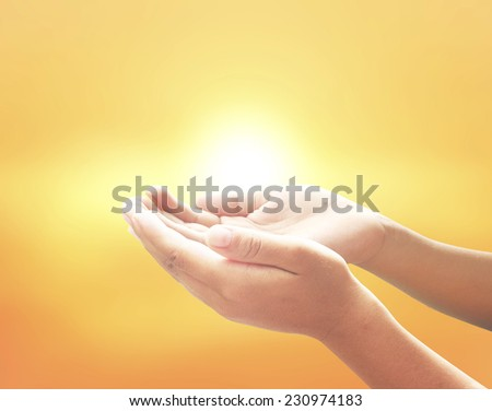 Human open empty hands with palms up, over blurred sunset background. Support Mercy Humble Evangelical Hallelujah Thankful Praise Redeemer Amen Pray Saturday Easter Sunday He Is Risen Morning concept.