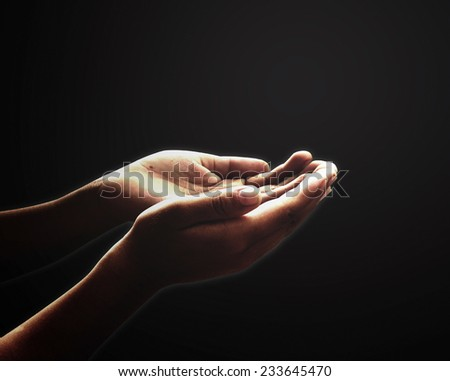 Human open two empty hands with palms up. Ask Pose Seek Beg Help Race God Well Soul Pray Dua Hajj Give Bless Quran Aura Heal Life Gift Eid Poor Idea Islam Thank Room Candle Glow National Day Prayer - stock photo