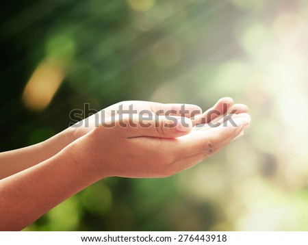 Human open two empty hands with palms up. Ask Pose Seek Beg Help Race God Well Soul Pray Dua Hajj Give Bless Quran Aura Heal Life Gift Eid Poor Idea Islam Thank Room Candle Glow Prayer CSR Healthy. - stock photo