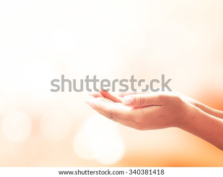 Human open two empty hands with palms up. Ask Seek Beg Help God Well Relax Soul Pray Dua Hajj Give Child Bless Quran Aura Heal Life Gift Eid Idea Islam Thank World Candle Glow National Day of Prayer - stock photo