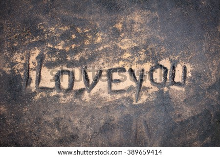 human painted i love you to surface of stone, dark toned