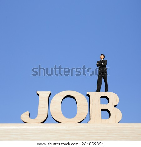 Human resource concept - business man stand on JOB text word and look sky, great for your design and business concept - stock photo
