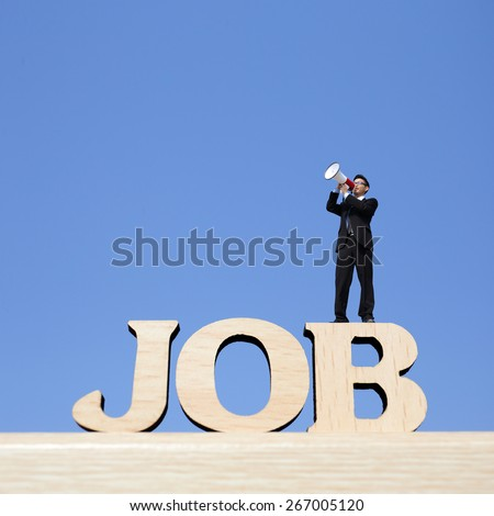 Human resource concept - business man stand on JOB text word and using megaphone shouting with blue sky background - stock photo