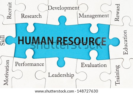 Human resource concept words on group of jigsaw puzzle pieces - stock photo