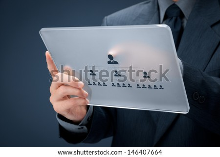 Human resources and corporate hierarchy concept - recruiter complete team by one leader person (CEO) represented by icon on futuristic glass tablet.  - stock photo