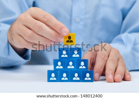 Human resources and corporate hierarchy concept - recruiter complete team by one leader person (CEO) represented by gold cube and icon.